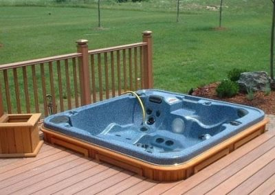 arctic spas hot tub in deck corner 1